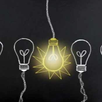 Creative idea. Concept of idea and innovation with light bulb on blackboard